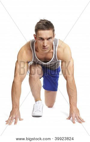 Muscular Young Man Ready To Race In Sports Outfit