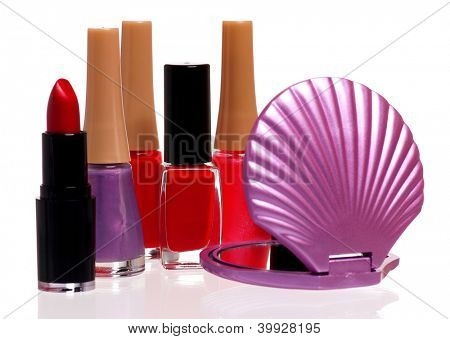 Set of cosmetics - nail polish, small mirror and lipstick isolated on white background