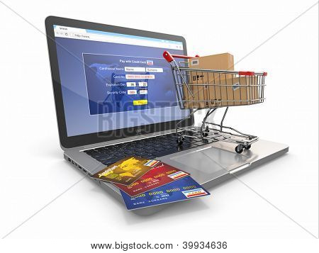 E-commerce. Shopping cart and credit cards on laptop. 3d