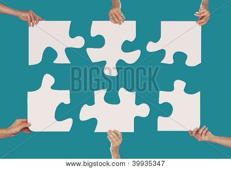 Woman hands holding puzzles together concept