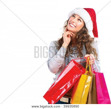 Happy Fashion Woman with Shopping Bags. Sales. Christmas Gifts. Christmas Shopping Girl Isolated on White Background. Christmas Gift. Choosing Gifts