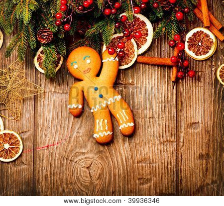 Gingerbread Man over Wood. Christmas Holiday Background.