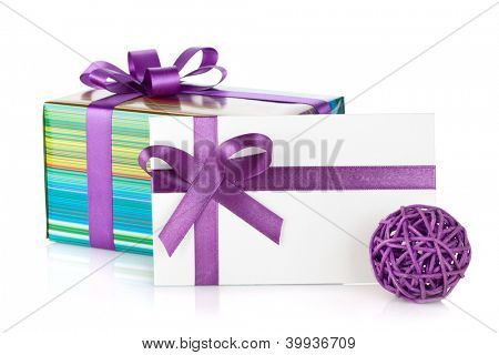 Colorful gift box and letter with ribbon and bow. Isolated on white background