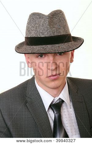 Elegant young man in hat