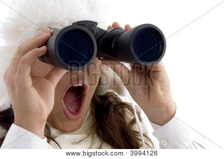 Beautiful Woman Looking Through Binocular