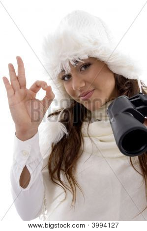 Woman Holding Binocular And Showing Okay Hand Gesture