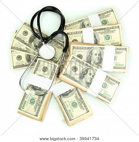 Healthcare cost concept: stethoscope and dollars isolated on white