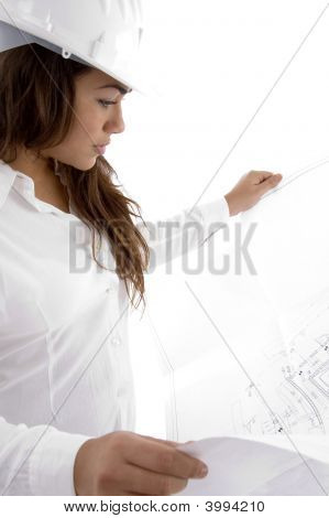 Young Female Architect Holding Open Blue Prints