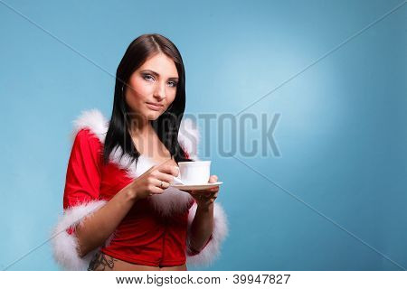 Beautiful Girl Santa Claus Girl Blowing Hot Drink