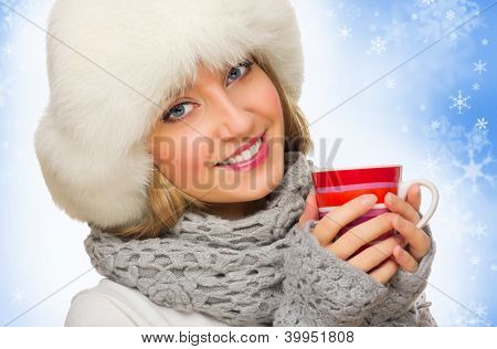 Young smiling girl with red mug isolated