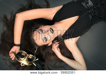 beautiful woman with golden mask