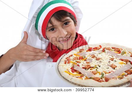Young boy dressed as a pizza chef