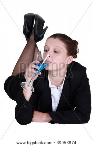 Businesswoman drinking a cocktail