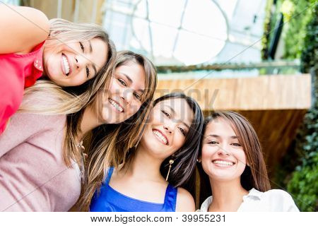 Happy group of beautiful young women smiling