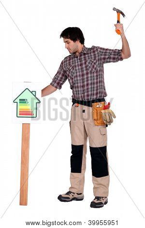 Man hamering post into ground