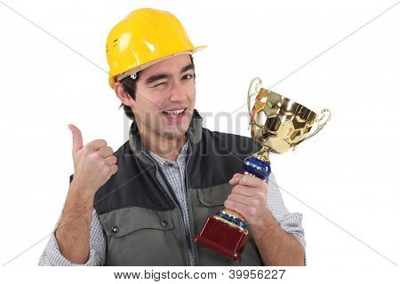 Craftsman winking holding trophy