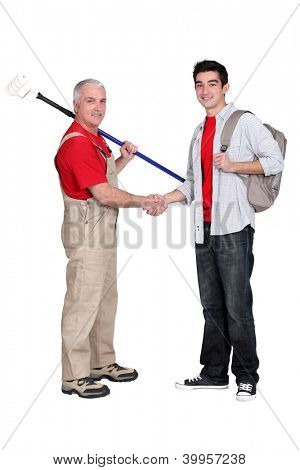 Decorator shaking hands with a young man