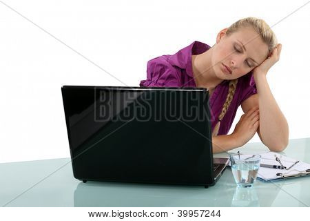 Employee falling asleep at her desk