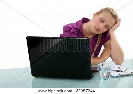 Employee falling asleep at her desk