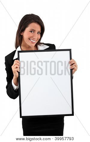 Smart young woman holding a blank board ready for your text