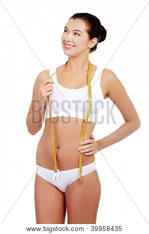 Pretty smiling woman with measurement type - isolated on white