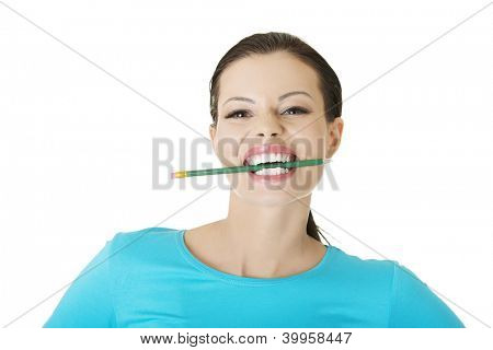 Thoughtful attractive student woman biting pencil, isolated on white