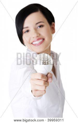 Businesswoman showing eco led bulb, isolated on white