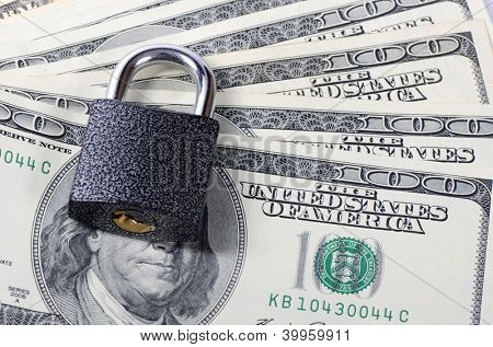Dollar denominations with the lock close up