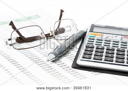 Pen, Calculator And Glasses