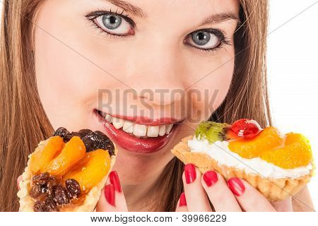 Girl Eats Two Cakes