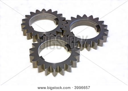 Three Gear Wheels On A White Background