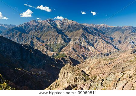 Arid colorful mountains under the blue sky