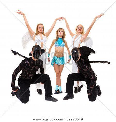 Actors Dressed As Angels And Demons Posing