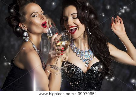 Happy Laughing Women Drinking Champagne And Singing Xmas Song
