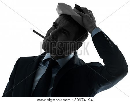 one causasian man sick with thermometer and ice pack  portrait in silhouette studio isolated on white background