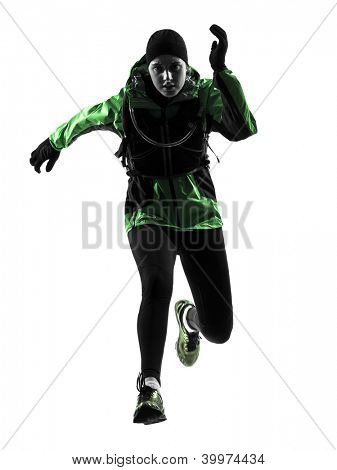 one causasian woman runner running trekking  in silhouette studio isolated on white background