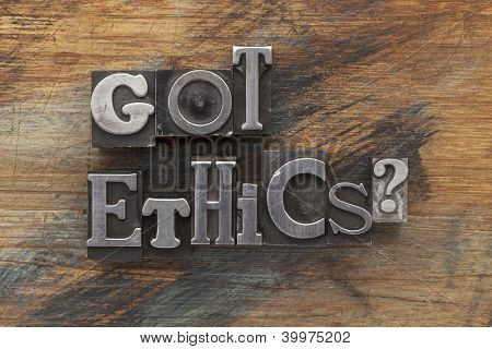 Got ethics question in vintage letterpress metal type on a grunge painted wood background