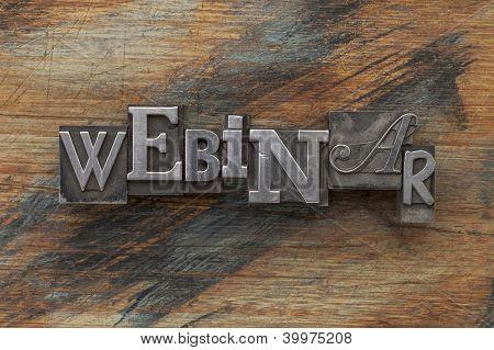 webinar word in vintage letterpress metal type on a grunge painted wood background