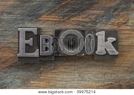 ebook word in vintage letterpress metal type on a grunge painted wood background