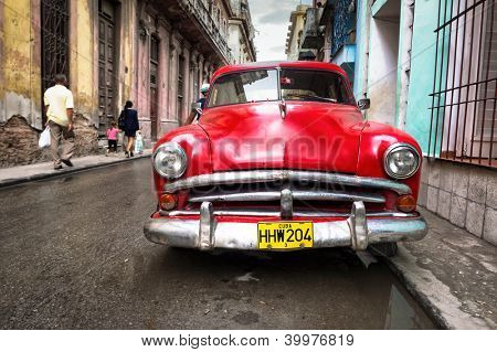 HAVANA-NOVEMBER 28:Old classic Buick in a shabby neighborhood November 28,2012 in Havana.Thousands of vintage cars are still in use in Cuba and they have become an iconic view of the cuban cities