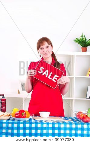 girl holding sale sign