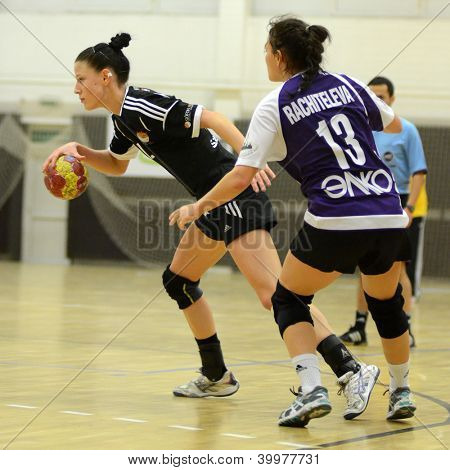 SIOFOK, HUNGARY - NOVEMBER 17: Unidentified players in action at EHF Cup handball match Siofok (black) (HUN) vs. Astrakhanochka (purple) (RUS) November 17, 2012 in Siofok, Hungary.
