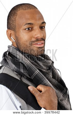 Closeup portrait of goodlooking young Afro-American man in scarf, smiling.