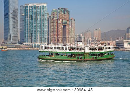 "HONG KONG - DECEMBER 3: Ferry ""Celestial star"" leaving Kowloon pier on December 3, 2010 in Hong Kong.Ferry is in operation in Victoria harbor for more than 120 years and is one of tourist attractions."