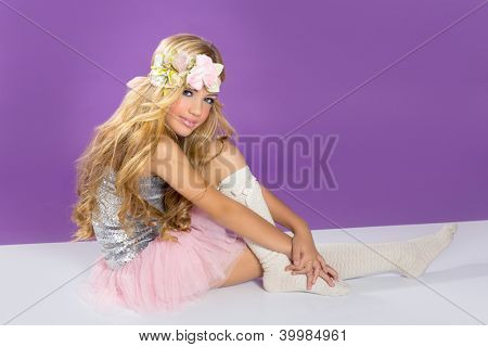 blond princess fashion girl fashiondoll with spring flowers on purple