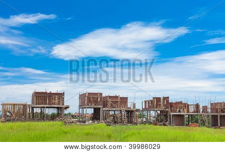 Villas under construction in Bali. Houses are being built in the middle of farming rice fields.