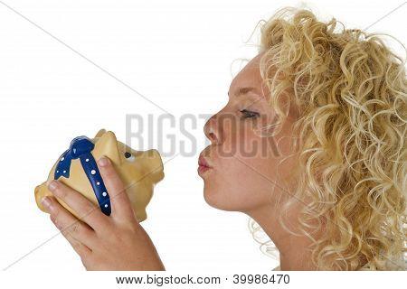 Young Woman Kissing Big Piggy Bank