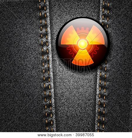 Radioactivity badge on black denim texture vector