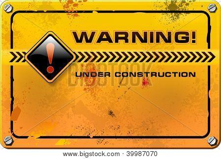 Under Construction, yellow grunge warning sign vector
