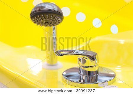 stopcock of jacuzzi with yellow bathtub